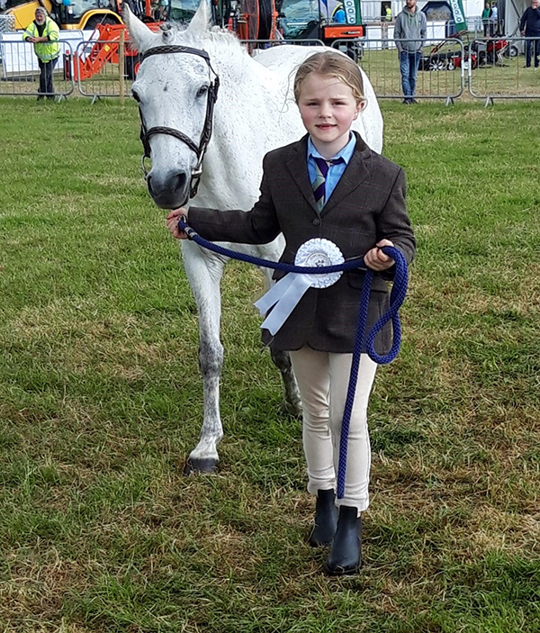ISPCA rescued pony Dromsligo Suil Amhain shown by Grace receives her first rosette!